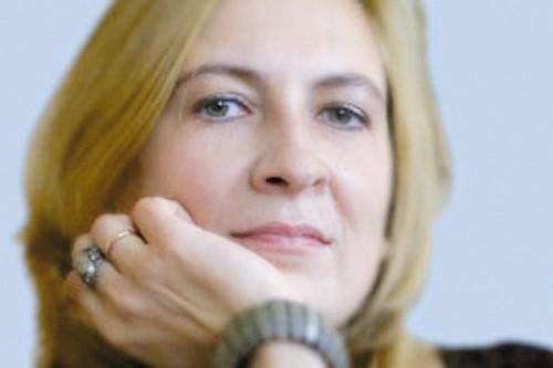 Людміла Рублеўская за прылаўкам кнігарні логвінаЎ