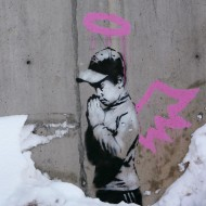 Artwork by the artist Banksy is shown on a wall during the Sundance Film Festival in Park City