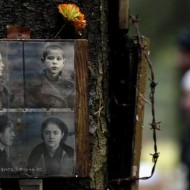 epa05609953 A view to the photos of Soviet people who were killed and buried in 1937-1938 in the woods in Levashovo, outside of St. Petersburg, Russia, 30 October 2016. The ritual is part of a commemoration of victims of the Soviet GULAG repression camps under Stalin's 'Great Terror' regime.  EPA/ANATOLY MALTSEV